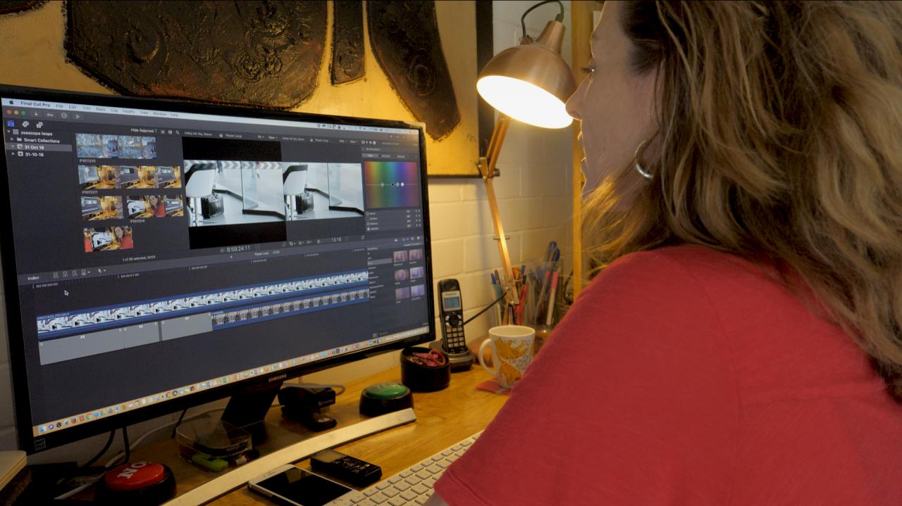 Zoe Harvey working in the edit suite